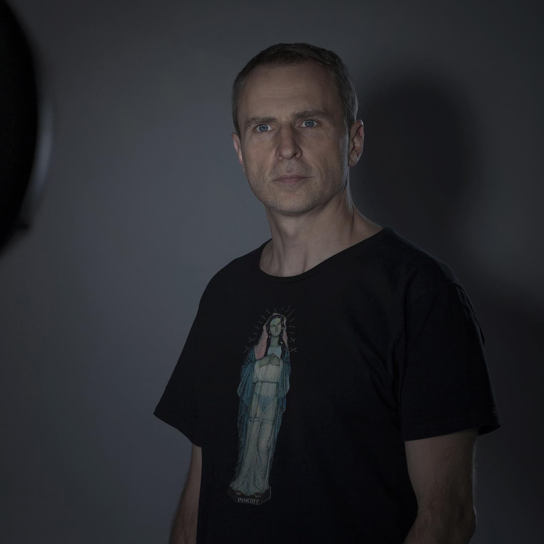 Portret fotografa Romana Mlejnka