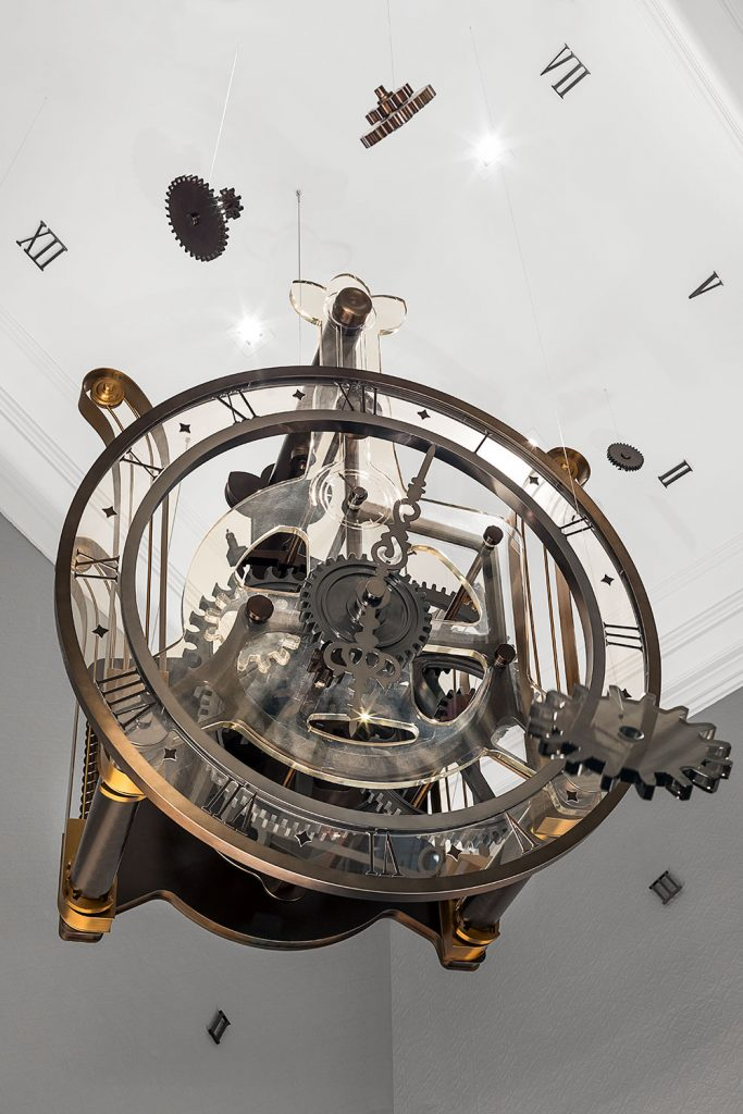 Detail of handmade time machine hanging in London hotel